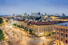 Old street with modern office buildings in the downtown, Warsaw, Royalty Free Stock Image