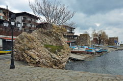Old street Nessebar, winter boat parking Stock Images