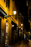 Old street by night in Bologna, Italy Stock Photo