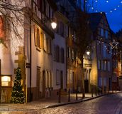 Old street at night in winter, Colmar, France Stock Images