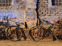 Old street and old bikes. Indian street: old wall and two old bikes royalty free stock photo