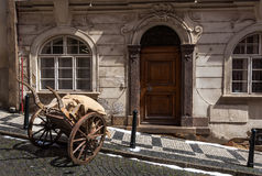 Old street with old cart in Prague Royalty Free Stock Photos