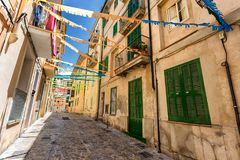 Old street of Palma de Mallorca with green doors and shutters royalty free stock photography