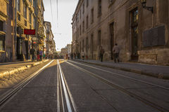 Old street with paving stones  at sunset. Old city Stock Image