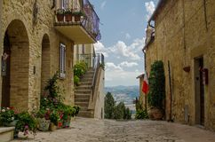 Old Street of Pienza with panoramic veiw. Tuscany. Italy Royalty Free Stock Photos