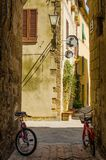 Old street in Pienza with two bycicle, Italy Stock Images