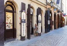 Old street in Prague town with souvenir shops Stock Image