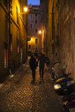 Old street in Rome. Tourist at  the old street of Rome at night, Italy Royalty Free Stock Photography