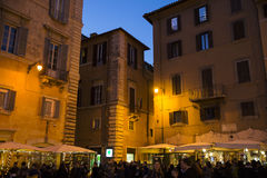 Old street in Rome. Tourist at  the old street of Rome at night, Italy.  28/12/2016 Royalty Free Stock Photo