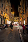 Old street in Rome. Tourist at  the old street of Rome at night, Italy. 28/12/2016 Stock Photos