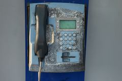 Old street rusty phone. Non-working shabby apparatus royalty free stock images