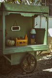 Old street seller cart with pumpkins. Decorative idea stock image