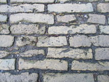 Old street of small bricks Stock Images