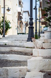 Old street with stony steps and sitting cat at Sitian town in eastern part of Crete island Stock Images