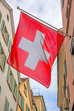 Old street with swiss flags, sunrays stock photos