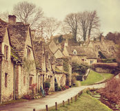 Old street with traditional cottages in Bibury. Stock Image