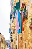 Old street with traditional houses and balconies Valletta. Old street with traditional houses and balconies in the city center, Valletta, Malta Stock Image