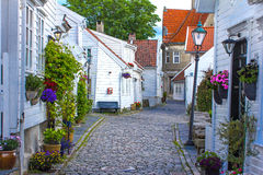 Old street with white wooden houses with tiled roofs. In the center of Stavanger, Norway Royalty Free Stock Photo