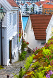 Old street with white wooden houses with tiled roofs Stock Photos