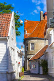 Old street with white wooden houses with tiled roofs Royalty Free Stock Images