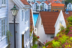 Old street with white wooden houses with tiled roofs Stock Images