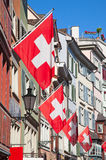 Old street in Zurich. Ancient street Augustinergasse in Zurich decorated with swiss flags Stock Images