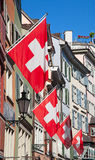 Old street in Zurich. Ancient street Augustinergasse in Zurich decorated with swiss flags Royalty Free Stock Images
