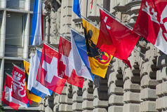 Old street in Zurich. Ancient street Augustinergasse in Zurich decorated with swiss flags Royalty Free Stock Photos