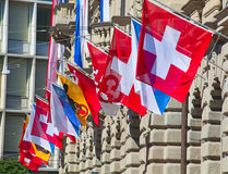 Old street in Zurich. Ancient Paradenplatz square in Zurich decorated with swiss flags Royalty Free Stock Photography
