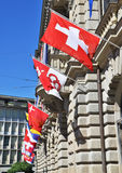 Old street in Zurich. Decorated with flags Stock Photo
