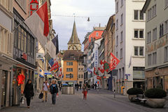 Old street in Zurich decorated with flags Royalty Free Stock Images