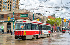 Old streetcar on a street of Toronto. The Toronto streetcar system is the largest and the busiest light-rail system in. Toronto, Canada - May 2, 2017: Old Stock Photos
