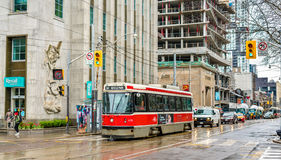 Old streetcar on a street of Toronto. The Toronto streetcar system is the largest and the busiest light-rail system in. Toronto, Canada - May 2, 2017: Old Stock Photo