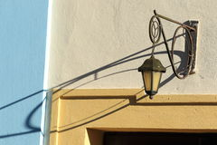 Old streetlamp. The historic streetlamp casting a shadow on the wall Stock Image