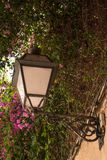 Old streetlamp on a wall. In Mallorca, Spain, on a summer day Stock Photo