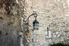 Old streetlight in the medieval village of Eze, France stock image