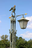Old streetlight in St. Petersburg. Old lantern in St. Petersburg on the blue sky background Royalty Free Stock Photos