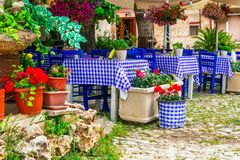 Traditional Greek tavernas. Cyprus island, Omodos village. Old streets with flowers ,Omodos village,Cyprus island stock photos