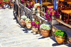 Floral streets and restaurants of old town Naxos. Ciclades islan. Old streets  of Greece,Naxos Stock Image