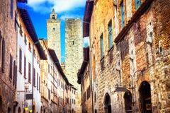 Traditional Italy - old narrow streets of medieval San Gimignano village. Royalty Free Stock Photos