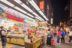 Old streets at night in Tamsui with people Stock Images
