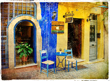 Old streets with tavernas. Pictorial streets in old venetian town Chania (Crete vector illustration