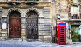 Old streets of Valletta downtown. Malta. Old streets of Valletta with english phone booth. Malta Stock Photos