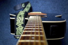 Old strings on black guitar Royalty Free Stock Images