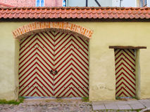 Old striped gate in the Old Town Stock Images