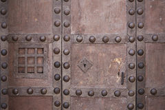 Old strong lock and cast iron latch with speakeasy window Stock Photos