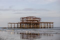 Old structure of a burned pier. In the sea Royalty Free Stock Photography
