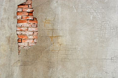 Old Stucco Wall. A damaged stucco wall with original brick exposed stock image