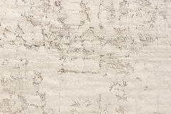 Old stucco wall with cracks and wear Royalty Free Stock Photography