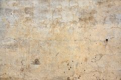Old stucco wall texture of beige color Stock Image